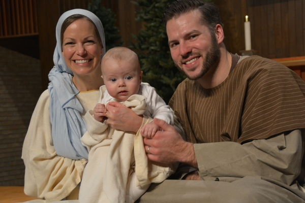 Young family as Joseph, Mary, and baby Jesus