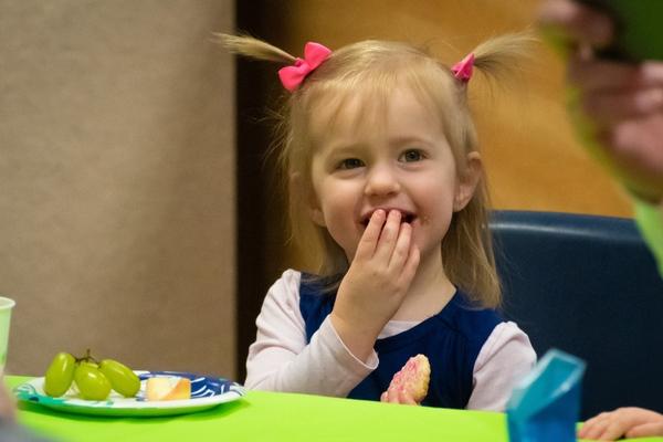 Young girl eating snacks