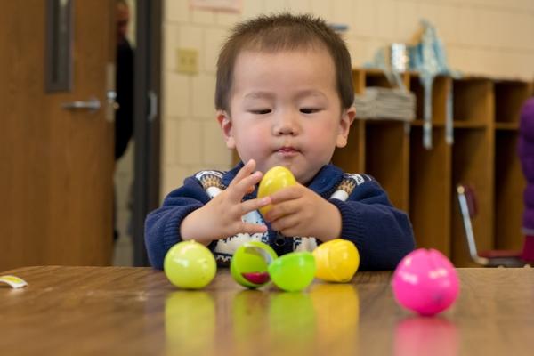 Toddler on an Easter egg hunt
