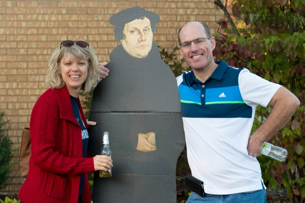 A couple poses with a Martin Luther standee