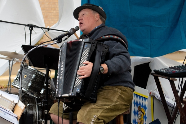 A man the polka band plays the accordion
