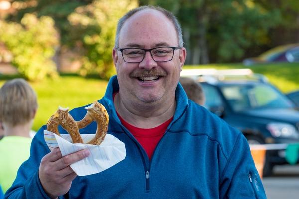 A man enjoys a giant pretzel