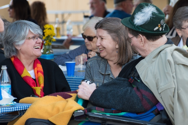 Three people taking after dinner at Oktoberfest