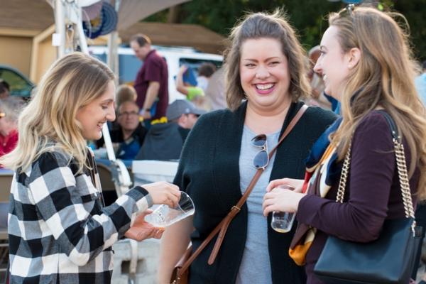 Three college students outdoors at Oktoberfest