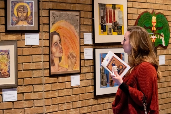 A college student looks at art in Cross View's sanctuary