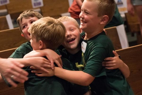 Boys hugging at VBS.