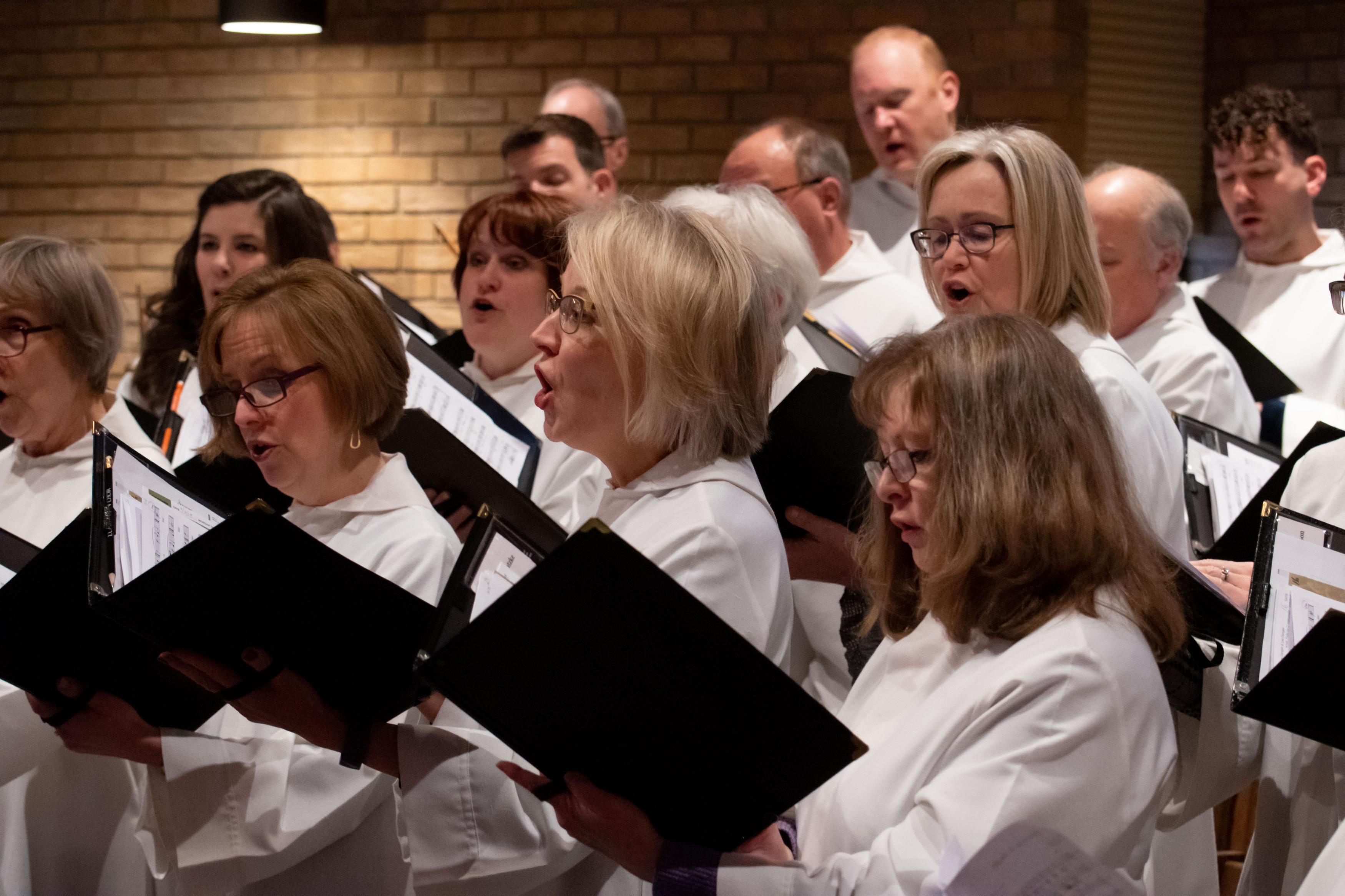 Choir sings in traditional worship