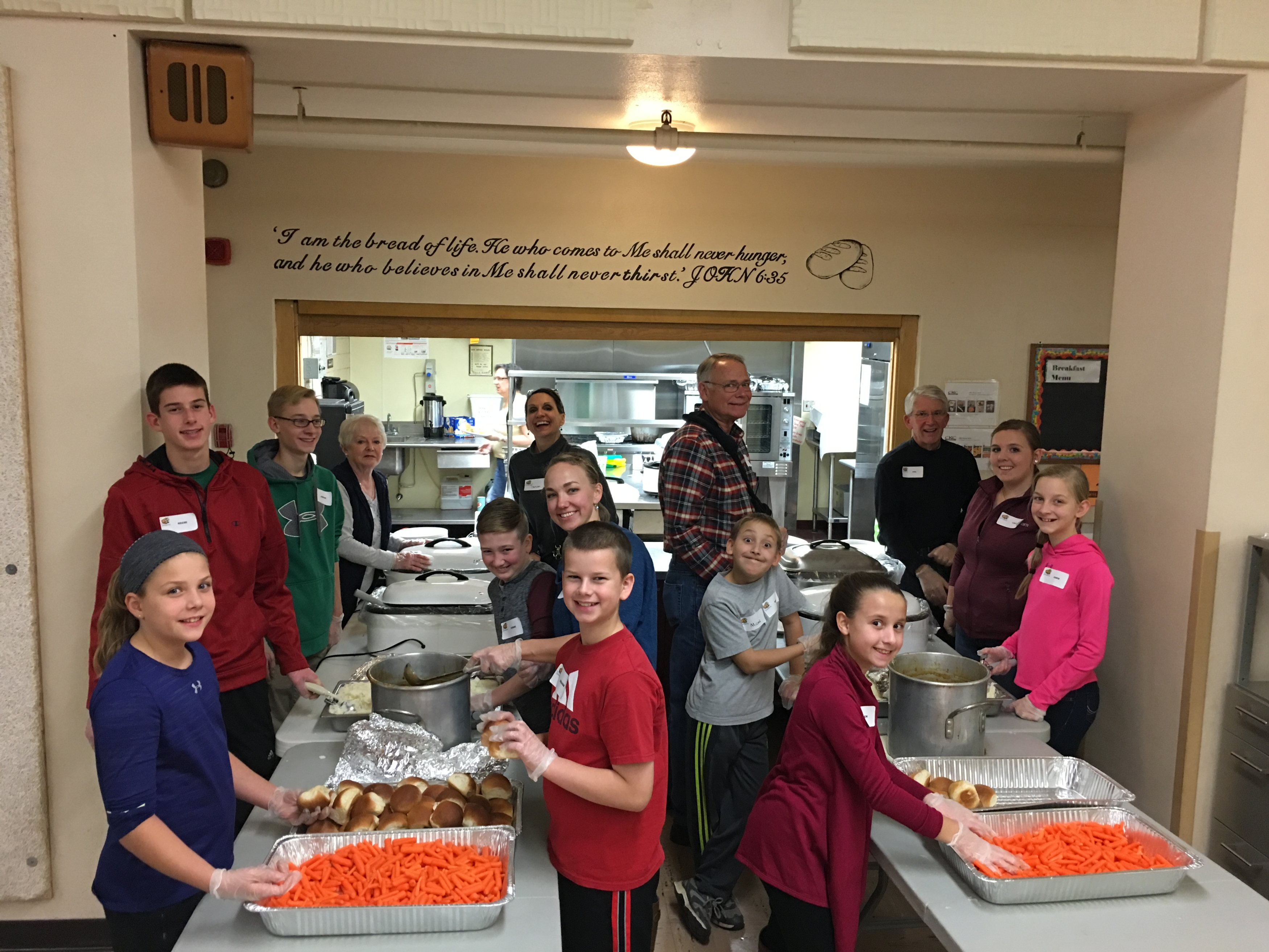 Cross View members prepare to serve the Thanksgiving meal at Trinity First School