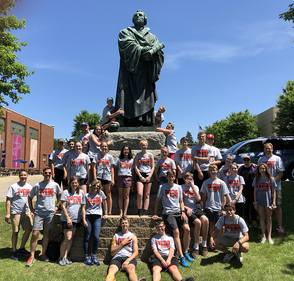Cross View Youth in front of the Martin Luther statue at Concordia University,  St. Paul